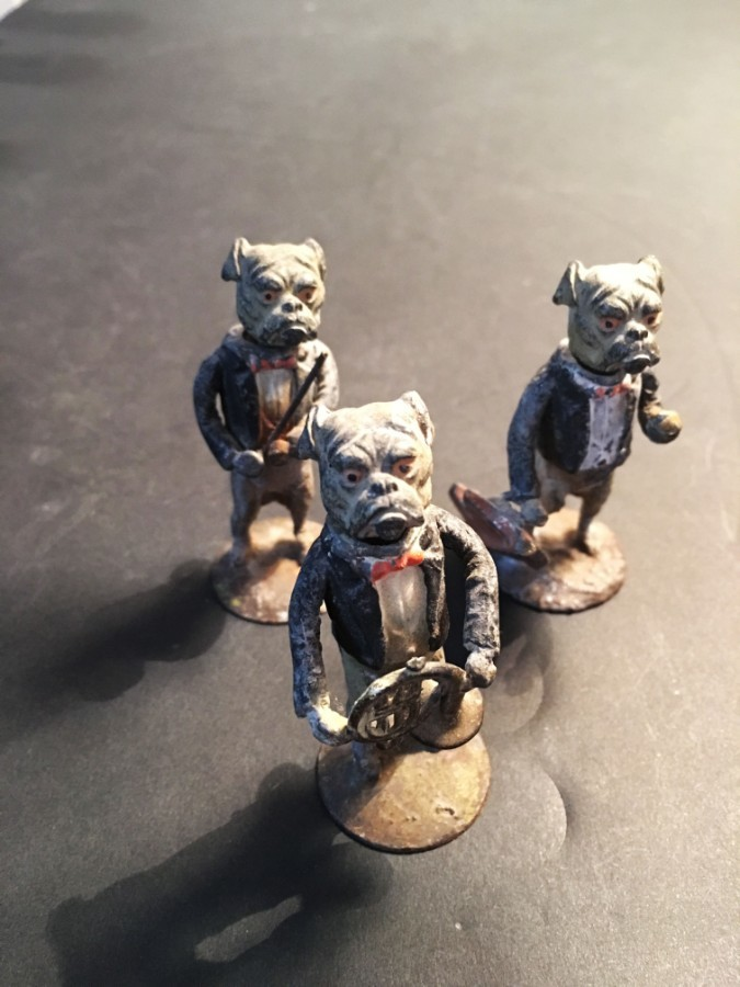 Three early 20th century painted lead nodding bulldog figures.