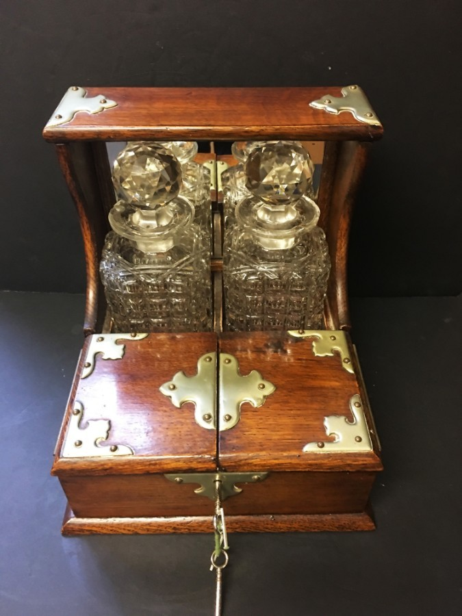 Antique  A late 19th Century oak Tantalus.