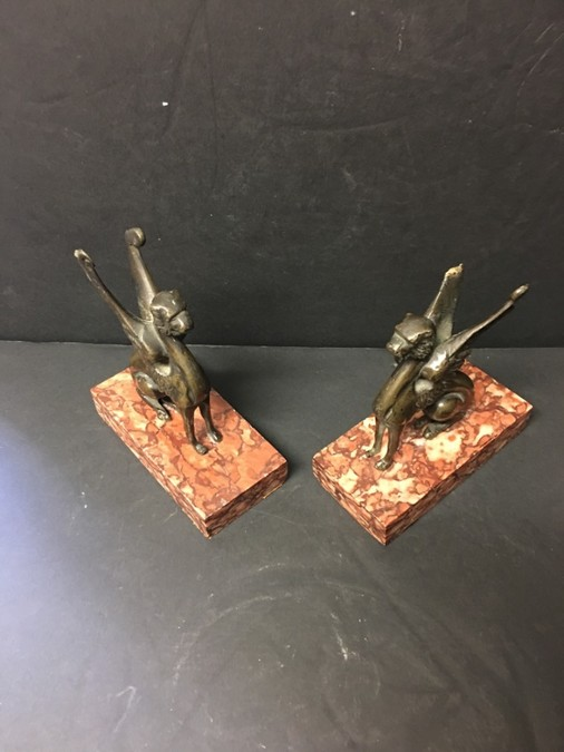 Antique A pair of 19th Century French Empire period Egyptian revival bronze winged griffins.