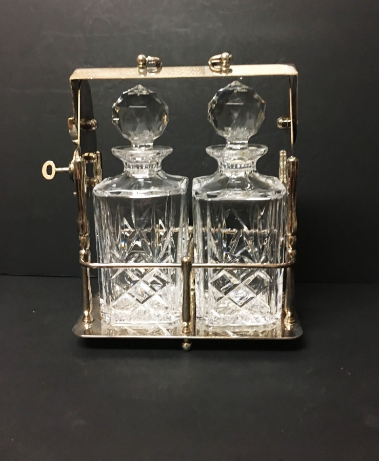 An early 20th Century silver plated tantalus.
