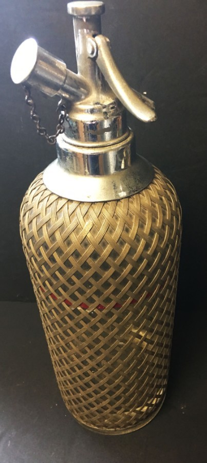 A 1930s Czechoslovakian metal clad glass soda siphon.