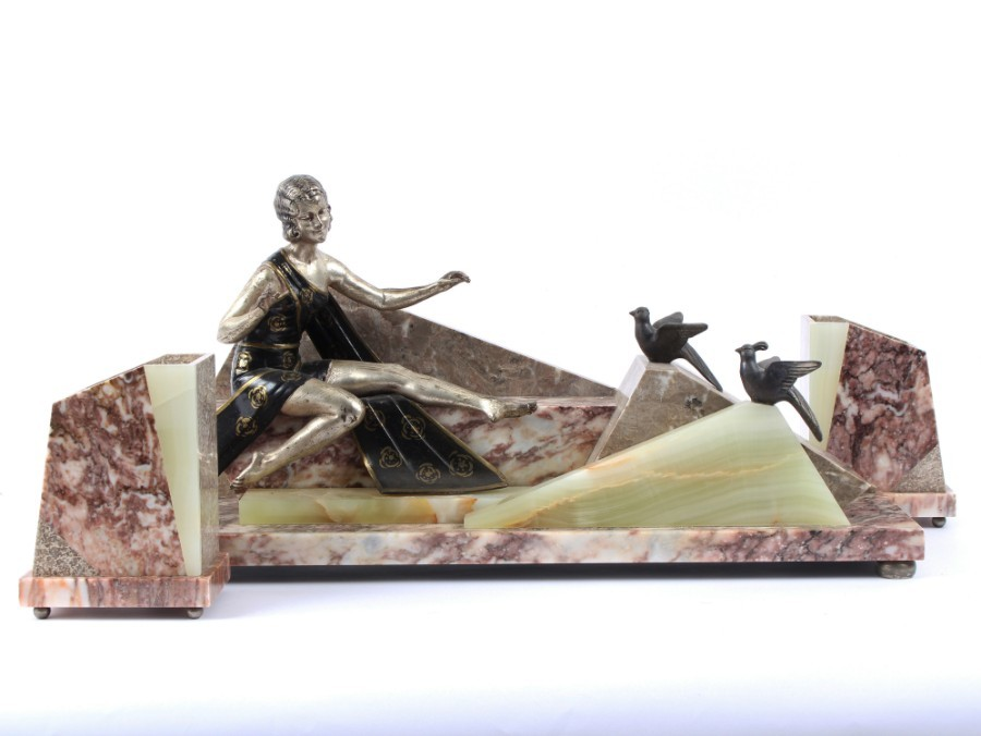 Art Deco style spelter, marble and onyx figure group.