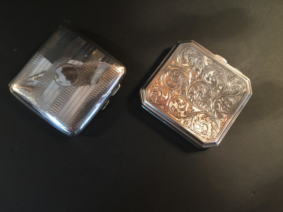 Two silver chased cigarette cases, Birmingham 1924.