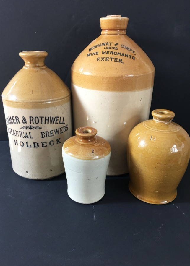 Collection of four stoneware flagons
