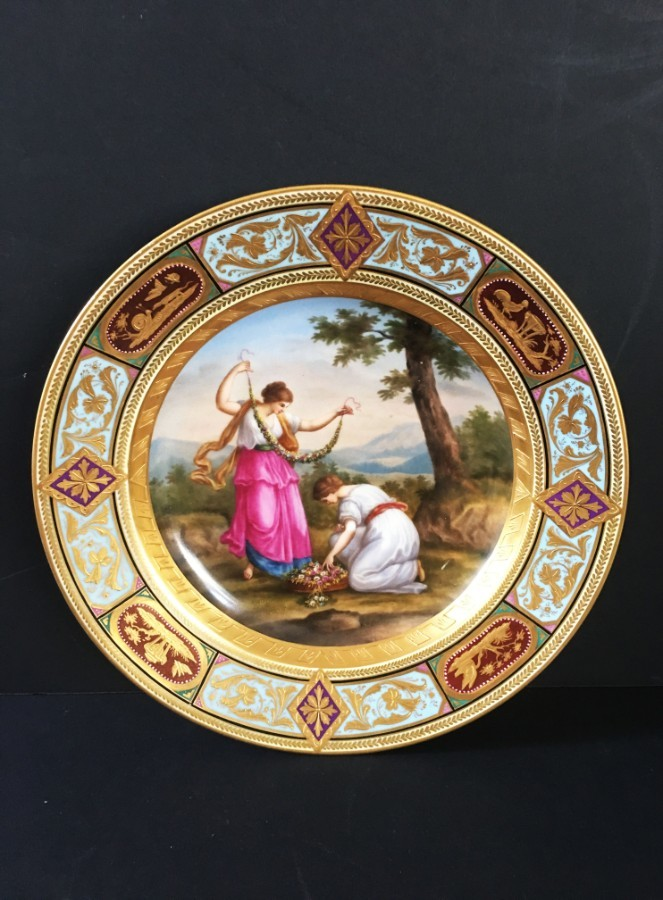 A Vienna porcelain hand-painted, gilt-edged cabinet plate.