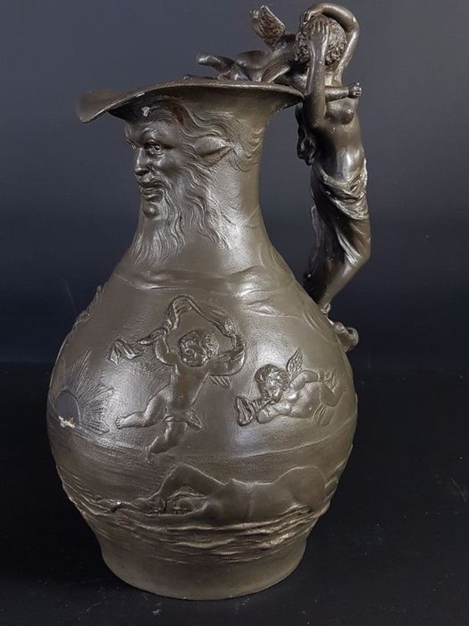 Pewter water jug.