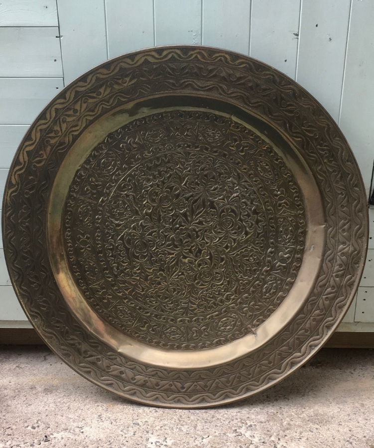 Very large brass arts and crafts design charger.