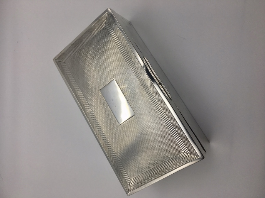 Silver cased rectangular cigarette box,