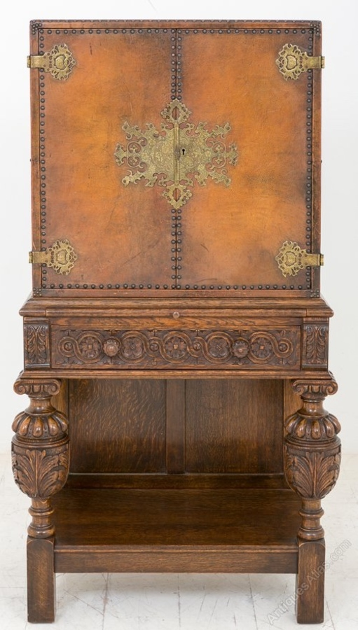Unusual Carved Oak and Leather Cabinet