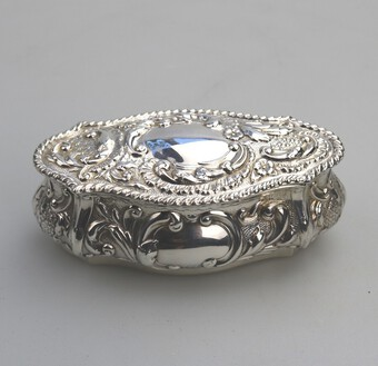 A fine antique solid silver Edwardian shaped gilt lined repousse Box C.1905