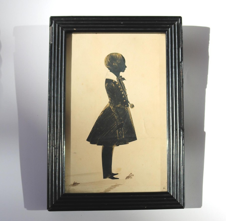 Antique Silhouette : A large bronzed full portrait picture of a Child C.19thC