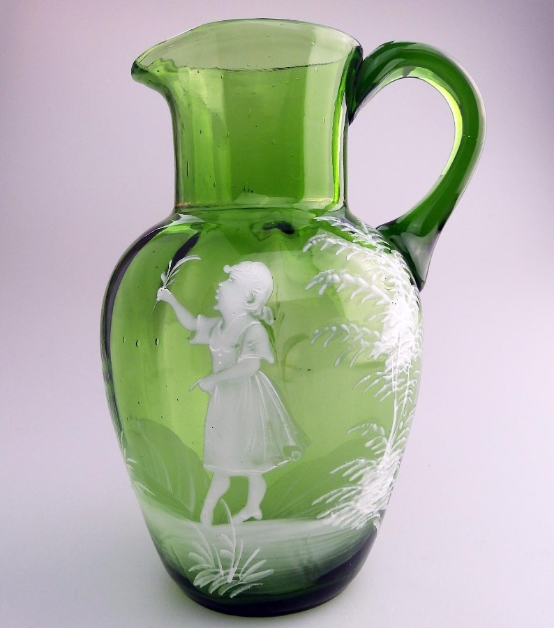 Antique Victorian Coloured Glass A green Mary Gregory girl h/enamel Jug C.19thC