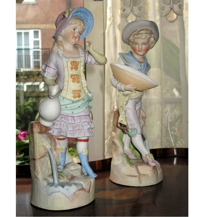Antique Bisque Pottery attractive pair of Victorian Figures C.19th/early 20thC