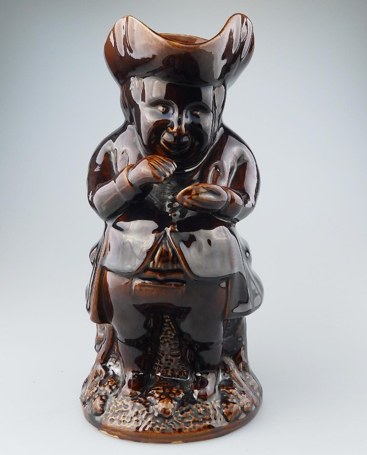 Antique Rockingham Antique Pottery : Treacle Glazed Pottery Snuff-Taker Toby Jug C.19thC