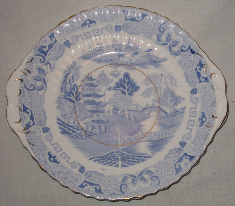 Antique English Pottery :  a pale blue & white Willow Pattern Platter C.19thC