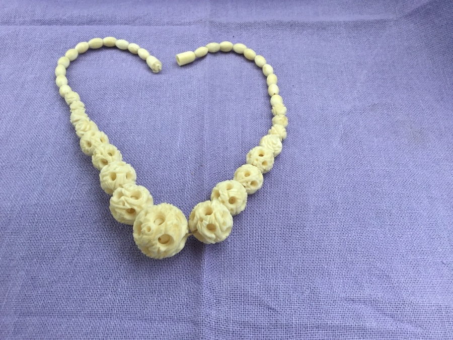 Beautiful antique hand carved Chinese ivory necklace with carved beads