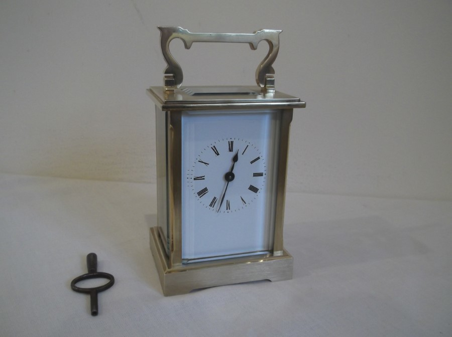EXCELLENT BRUSHED BRASS CASED 8 DAY CARRAIGE CLOCK by KJB.