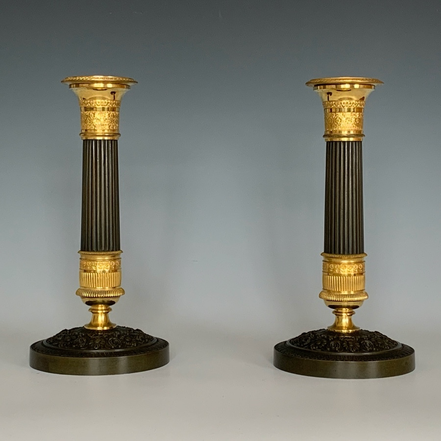 A Pair of French Empire Ormolu & Bronze Candlesticks