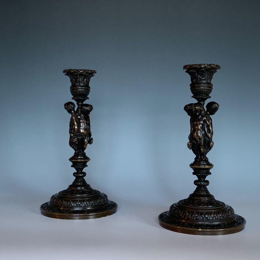 A Pair of French Bronze Candlesticks By Henri Picard