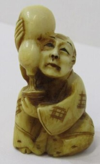 Japanese Ivory carved NETSUKE of a Man with a double gourd bottle