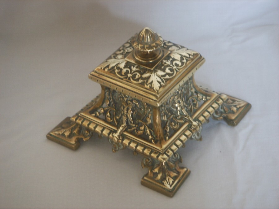 AN ORNATE PIERCED BRASS INKWELL. HEAVY.