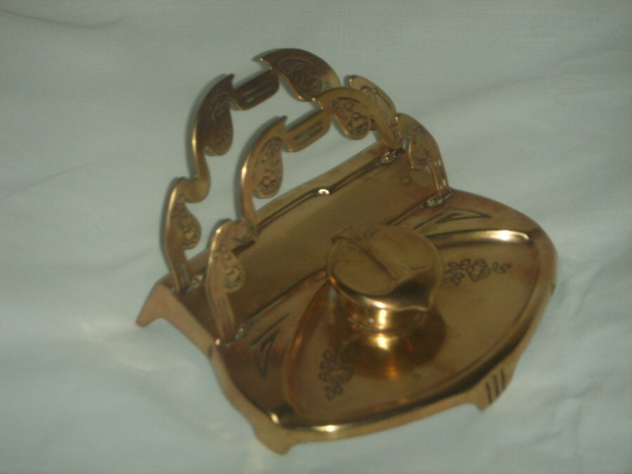 AN ART NOUVEAU INKWELL with LETTER RACK