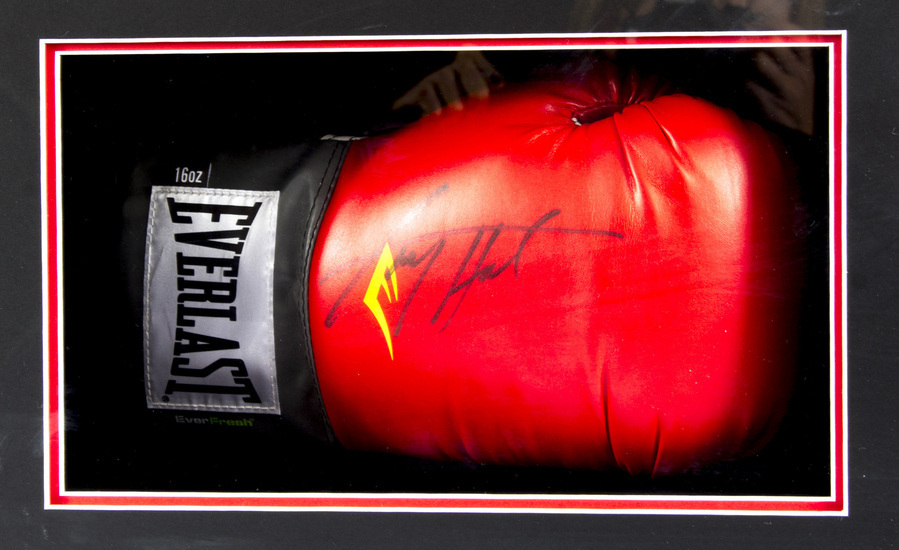 Antique Everlast boxing glove autographed by Larry Holmes