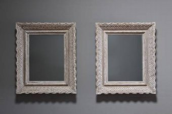 A pair of carved wood and gessoed mirrors by Bouche