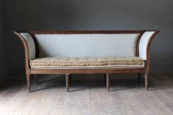 An elegant C18th French oak sofa
